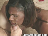 Tranny gets face full of cum